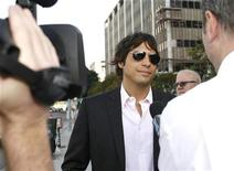 """<p>""""Girls Gone Wild"""" video series producer Joe Francis arrives at the Edward R. Roybal Federal Building in Los Angeles July 21, 2008. A Los Angeles court on Monday issued an arrest warrant for Francis for failing to appear at a hearing in a tax evasion case. REUTERS/Mario Anzuoni</p>"""