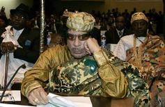 <p>Libyan leader and the new chairman of the African Union, Muammar Gaddafi, listens in during the opening session of the 12th African Union Summit in Ethiopia's capital Addis Ababa, February 2, 2009. REUTERS/Antony Njuguna</p>