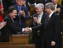 <p>Canada's Finance Minister Jim Flaherty (L) shakes hands with Prime Minister Stephen Harper after delivering his budget in the House of Commons on Parliament Hill in Ottawa in this January 27, 2009 file photo. Parliament voted overwhelmingly to back the federal budget on Tuesday, ensuring the survival of the minority Conservative government. REUTERS/Tom Hanson/Pool</p>