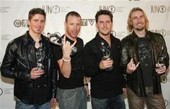 <p>Daniel Adair, Mike Kroeger, Ryan Peake and Chad Kroeger (L-R) of Nickelback hold up their Canadian Juno awards after winning the Rock Album of the Year at a gala in Halifax, Nova Scotia April 1, 2006. REUTERS/Paul Darrow</p>