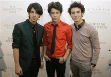 <p>(From L to R) The Jonas Brothers, Joe Jonas, Nick Jonas, and Kevin Jonas, arrive at The Huffington Post Pre-Inaugural Ball in Washington, DC January 19, 2009. REUTERS/Mitch Dumke</p>