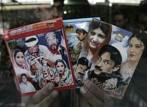 <p>A shopkeeper show Drama CD's and DVD's in his shop in Peshawar, February 6, 2009. REUTERS/Ali Imam</p>