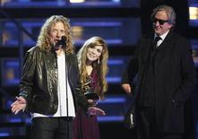 """<p>Robert Plant (L) and Alison Krauss accept their Grammy for Record of the Year for """"Please Read The Letter"""", as producer T-Bone Burnett (R) watches on, at the 51st annual Grammy Awards in Los Angeles February 8, 2009. REUTERS/Lucy Nicholson</p>"""