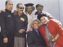 "<p>Cuban singers of the Buena Vista Social Club (L-R standing), Orlando""Cachaito"" Lopez, Barbarito Torres, Juan De Marcos, Ibrahim Ferrer, (below) Compay Segundo and Omara Portunado are seen in this file photo taken in Mexico City, February 26, 2003. REUTERS/Henry Romero/File</p>"
