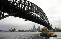 <p>A ferry aproaches Sydney's central business district February 3, 2009. REUTERS/Daniel Munoz</p>