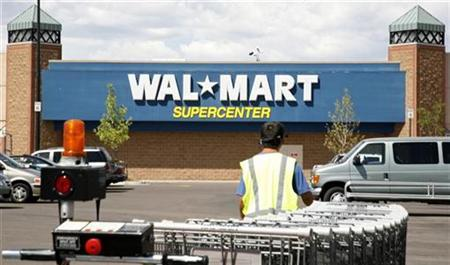 A worker brings carts back into a Walmart store in Westminster, Colorado August 14, 2008. REUTERS/Rick Wilking