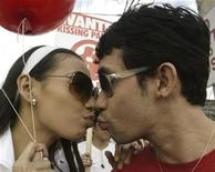 <p>A Filipino couple kiss during a rally before marching towards the Hungarian embassy in Makati's financial district of Manila January 24, 2007, as a sign of their determination to regain the 'Kiss festival' record. REUTERS/Joseph Agcaoili</p>