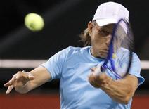 <p>Martina Navratilova of the U.S. returns the ball against Kimiko Date of Japan at their friendly match during Dream Match 2008 in Tokyo March 15, 2008. Former tennis champions Navratilova, Steffi Graf of Germany and Date participated in the friendly tennis match. REUTERS/Kim Kyung-Hoon</p>