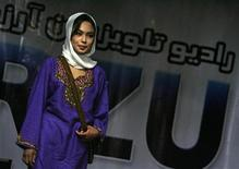 <p>An Afghan contestant poses during a fashion competition initiated by a private television channel in the city of Mazar-I-Shariff, north of Kabul, in this file picture taken September 25, 2007. REUTERS/Ahmad Masood/Files</p>