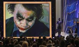 """<p>Cast member Gary Oldman accepts the Outstanding Performance by a Male Actor in a Supporting Role for Heath Ledger for """"The Dark Knight"""" at the 15th annual Screen Actors Guild Awards in Los Angeles January 25, 2009. REUTERS/Lucy Nicholson</p>"""