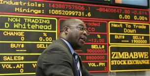 <p>A broker makes a bid at the morning trading session of the Zimbabwe Stock Exchange in the capital Harare, April 3, 2008. REUTERS/Howard Burditt</p>