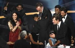 """<p>Director Danny Boyle (C) celebrates with young actors Azharuddin Ismail (L) and Ayush Mahesh (R) as they are surrounded by other cast and crew members after """"Slumdog Millionaire"""" won the Oscar for best picture during the 81st Academy Awards in Hollywood, California February 22, 2009. REUTERS/Gary Hershorn</p>"""