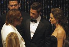 """<p>Nominee Brad Pitt (C) for best actor for his role in """"The Curious Case of Benjamin Button"""" talks with nominee for best actor Mickey Rourke for his role in """"The Wrestler"""", and nominee for best actress Angelina Jolie (R) for her role in """"Changeling"""" during the 81st Academy Awards in Hollywood, California February 22, 2009. REUTERS/Gary Hershorn</p>"""