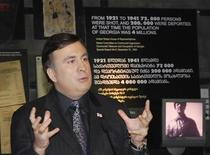 <p>Georgia's President Mikheil Saakashvili speaks with students during a meeting at the Soviet Occupation Museum in Tbilisi February 25, 2009. REUTERS/Natia Papavadze/Pool</p>