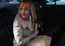 <p>J.K. Rowling, author of the Harry Potter book series, sits in her car after leaving the U.S. District Court in New York April 15, 2008. REUTERS/Joshua Lott</p>