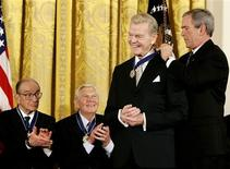 <p>Then-President George W. Bush (R) awards his Presidential Medal of Freedom to long-term radio commentator Paul Harvey as fellow awardees, former Chairman of the Federal Reserve Alan Greenspan (L) and actor Andy Griffith (2nd L) look on at a ceremony in the East Room of the White House in Washington in this November 9, 2005 file photo. Harvey died on February 28, 2009, ABC Radio Networks announced. REUTERS/Jason Reed/Files</p>