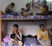 <p>11 year-old orphan Salah Abbas (top R) shows his picture with other medals hung on the wall while sitting with other roommates in a room at the Safe House orphanage in Baghdad's Sadr City February 11, 2009. REUTERS/May Naji</p>