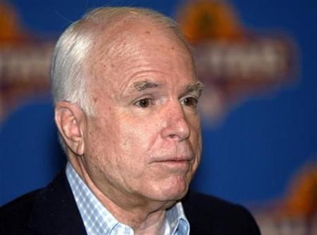 Senator John McCain (R-AZ) speaks at a news conference before the NBA All-Star basketball game at the U.S. Airways Center in Phoenix, Arizona February 15, 2009. REUTERS/Rick Scuteri