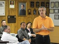 """<p>Kim Childers, who has just been laid off from his job at JC Penneys, introduces himself to the other """"job club"""" members during an early morning meeting at the Prince of Peace Catholic Church in Olathe, Kansas February 25, 2009. REUTERS/Dave Kaup</p>"""