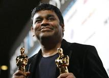 "<p>Composer A.R. Rahman holds the Oscars for achievement in music for both original song and original score for his work on the film ""Slumdog Millionaire"" at the official Oscar after party for Fox Searchlight's ""Slumdog Millionaire"" and ""The Wrestler"" in Los Angeles February 22, 2009. REUTERS/Mario Anzuoni</p>"