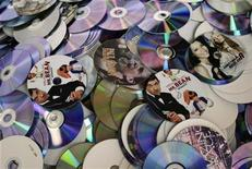 <p>A Mr. Bean DVD is seen among some of the R25 million worth of pirated DVD's and CD's that were destroyed by authorities in Midrand ,February 19 ,2009. Some local artists came to witness the pirated copies of their own work being crushed. Reuters/Siphiwe Sibeko</p>