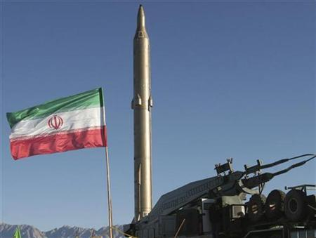 An Iranian surface-to-surface missile rests on a launch platform in preparation for a test firing at an undisclosed location in the Iranian desert in this image released to Fars News by the military November 12, 2008. REUTERS/FARS NEWS