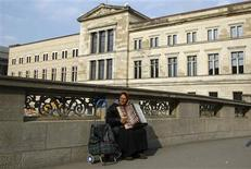 <p>A women plays an accordion in front of the 'Neues Museum' (New Museum) building on Museum Island in Berlin March 5, 2009. The reconstructed 'Neues Museum' building by British architect David Chipperfield on Berlin's Museum Island, will be open to the public in October 2009. REUTERS/Fabrizio Bensch</p>