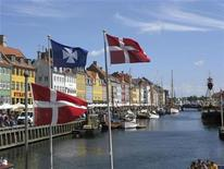 <p>The Nyhavn canal, part of the Copenhagen Harbor and home to many bars and restaurants, is seen August 11, 2008. In times like these, no one is immune to depression. But surveys show the Danes are the happiest people in the world, and a core factor is a quality in global short supply -- trust. REUTERS/Teis Hald Jensen</p>