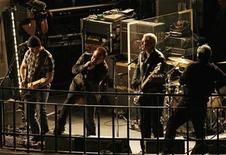 <p>Irish band U2 play on the roof of the BBC Broadcasting House building in London February 27, 2009. REUTERS/Stephen Hird</p>