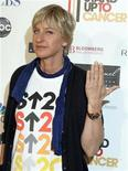 <p>Talk show host Ellen DeGeneres shows her wedding ring as she arrives at the Stand Up To Cancer broadcast event in Hollywood September 5, 2008. REUTERS/Fred Prouser</p>