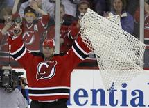 <p>New Jersey Devils goalie Martin Brodeur celebrates after beating the Chicago Blackhawks for his 552nd career victory at their NHL game in Newark, New Jersey, March 17, 2009. REUTERS/Gary Hershorn</p>