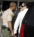 <p>Adnan Ghalib (R) stands outside an SUV carrying Britney Spears before leaving the Los Angeles County courthouse in Los Angeles January 14, 2008. Ghalib was ordered on Wednesday to stay away from the singer and her family for three years. REUTERS/Danny Moloshok</p>