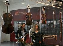"<p>Visitors look at musical instruments displayed at the exhibition ""Viva Mozart"" celebrating Mozart's 250th birthday in Salzburg's New Residence in this file photo from January 26, 2006. REUTERS/Herwig Prammer</p>"