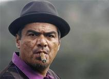<p>Comedian George Lopez smokes a cigar on the third hole during the Celebrity Challenge charity event at the Pebble Beach National Pro-Am golf tournament in Pebble Beach, California, February 11, 2009. REUTERS/Michael Fiala</p>