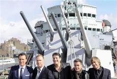 <p>British band Spandau Ballet pose for photographers during a photocall on HMS Belfast in central London March 25, 2009. Pictured are (L to R) Martin Kemp, Gary Kemp, Tony Hadley, John Keeble, Steve Norman. REUTERS/Toby Melville</p>