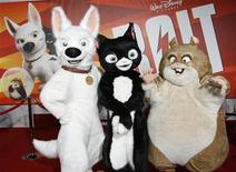 """<p>Characters Bolt, Mittens and Rhino (L-R) from the animated film """"Bolt"""" from Walt Disney Animation Studios pose at the film's premiere in Hollywood November 17, 2008. REUTERS/Fred Prouser</p>"""