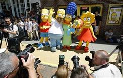 "<p>Characters in the film and television show ""The Simpsons"" pose for photographers in Springfield, Vermont July 21, 2007. REUTERS/Lucas Jackson</p>"