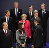 <p>U.S. President Barack Obama (bottom R) greets Canadian Prime Minster Stephen Harper (middle R) as he is watched by Czech Republic's Prime Minister Mirek Topolanek (top L), Head of the Financial Stability Forum Mario Draghi (top C), President of the World Bank Robert Zoellick (top R), Spain's Prime Minister Jose Luis Rodriguez Zapatero (middle L), German Chancellor Angela Merkel (middle C), Mexico's President Felipe Calderon (bottom L) and Argentina's President Cristina Fernandez de Kirchner (bottom C) as they prepare to pose for a second family photograph at the G20 summit at the ExCel centre, in east London, April 2, 2009. Canadian Prime Minster Stephen Harper missed the first family photograph, which had to be shot a second time. REUTERS/Dylan Martinez</p>