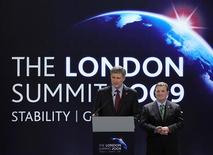 <p>Canada's Prime Minister, Stephen Harper (L) watched by Finance Minister Jim Flaherty, speaks at a news conference after the G20 summit at the ExCel centre, in east London April 2, 2009. World leaders agreed a trillion-dollar deal on Thursday to combat the deepest economic downturn since the Great Depression. REUTERS/Dylan Martinez</p>
