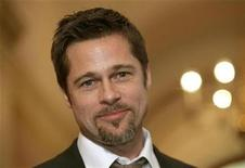 "<p>Actor Brad Pitt appears for a photo op before a meeting with House Speaker Nancy Pelosi on ""Make it Right,"" a project launched in 2007 to construct affordable and environmentally-sustainable housing for low-income residents of the Lower 9th Ward in New Orleans who lost their homes as a result of Hurricane Katrina, in the U.S. Capitol in Washington March 5, 2009. REUTERS/Molly Riley</p>"