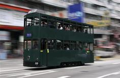 <p>A tram passes by in downtown Hong Kong April 7, 2009. REUTERS/Tyrone Siu</p>