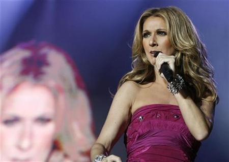 Celine Dion performs on stage at the Stade de Geneve in Geneva July 9, 2008. REUTERS/Denis Balibouse
