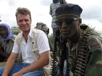 <p>Reuters East Africa Bureau Andrew Cawthorne sits next to a Somali gunman during his visit in this July 2006 file photo. Reporting on Somali piracy can be surreal. While some in the world only woke up to the phenomenon with the first seizure of an American hostage, Somalia's modern-day buccaneers have been marauding off the Horn of Africa for years, taking hundreds of captives and millions in ransoms. Covering their exploits is a near-daily task for reporters in Somalia and foreign correspondents in East Africa. REUTERS/Andrew Cawthorne</p>