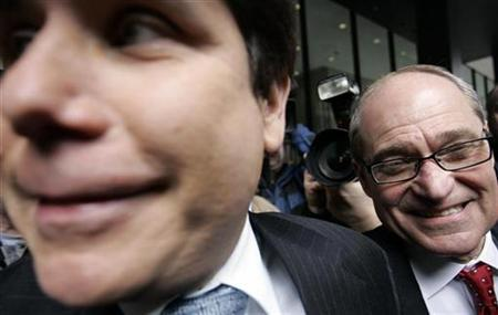 Former Illinois Governor Rod Blagojevich (L) and attorney Sheldon Sorosky smile as they leave the Dirksen federal building after his arraignment hearing in Chicago, Illinois April 14, 2009. REUTERS/Frank Polich