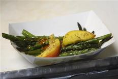 <p>A grilled asparagus order, the chef's choice special of the night, is seen inside a Kogi Korean BBQ-inspired taco truck, in Torrance, California, April 17, 2009. REUTERS/Danny Moloshok</p>