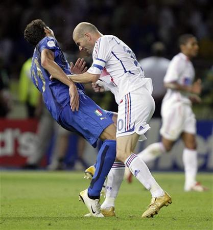 In this file photo Italy's Marco Materazzi falls on the pitch after being head-butted by France's Zinedine Zidane (R) during their World Cup 2006 final match in Berlin July 9, 2006. FIFA RESTRICTION - NO MOBILE USE HOLLAND OUT Picture taken July 9, 2006. REUTERS/Peter Schols/GPD/Handout