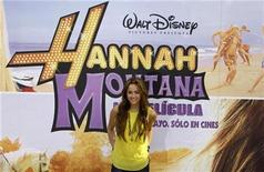 """<p>U.S. actress Miley Cyrus poses during a photocall to promote her film """"Hannah Montana the Movie"""" in Madrid April 22, 2009. REUTERS/Sergio Perez</p>"""