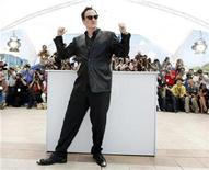 <p>U.S. director Quentin Tarantino poses as he attends a photocall before giving a cinema master class at the 61st Cannes Film Festival May 22, 2008. REUTERS/Eric Gaillard</p>