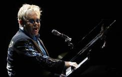 """<p>Britain's Elton John performs during his show called """"The Red Piano"""" at La Bombonera stadium in Buenos Aires January 22, 2009. REUTERS/Marcos Brindicci</p>"""