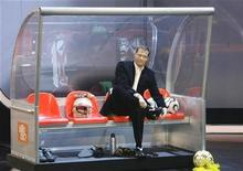 "<p>German actor Til Schweiger puts on soccer shoes during the German television show ""Wetten dass...?"" (Bet it...?) in Stuttgart December 13, 2008. REUTERS/Michaela Rehle</p>"